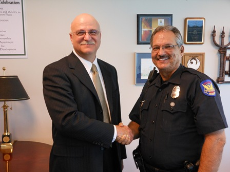 Newly appointed Phoenix Police Chief Danny Garcia  being congratulated by PLEA President Joe Clure.