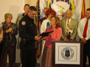 Officer Rusty Stuart of the Squaw Peak Precinct receives the first annual 'To Protect and Serve' award presented by Indian School Corridor-Citywide Association President Ann Malone.