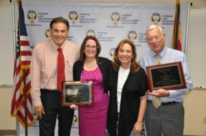 (pictured L-R, City Manager David Cavazos, award recipient Lisa Hubbard, Require the Prior President, Ann Malone, and award recipient Paul Barnes)