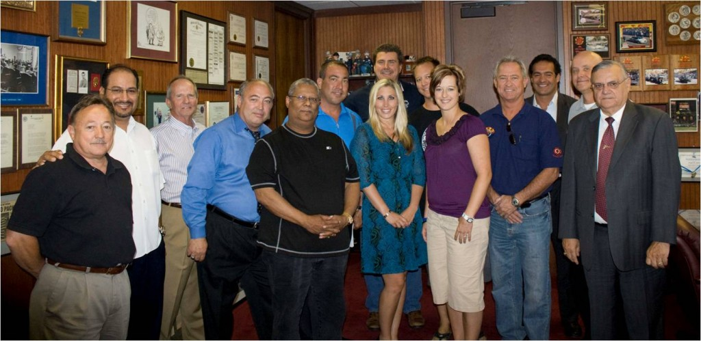 (Pictured left to right) Ray Jones, Hugh Hernandez, Greg Warthen, Chief Brian Sands, Levi Bolton, Steve Colla, Heather Hendon, Mark Spencer, brother of Danielle Murphy, Danielle Murphy, Danielle's father, Mike Cruzado, Dave Kothe, and Sheriff Joe Arpaio